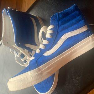 Blue suede Vans high top sneakers